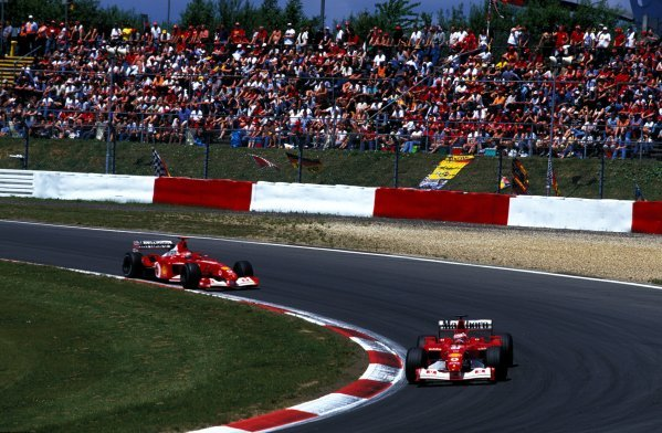 Rubens Barrichello (BRA) Ferrari F2002 ahead of Michael Schumacher (GER) Ferrari F2002. The pair took a Ferrari 1-2.European Grand Prix, Nurburgring, Germany, 23 June 2002.BEST IMAGE