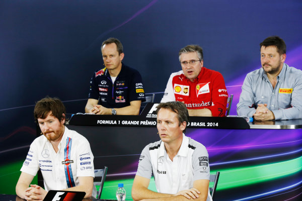 Interlagos, Sao Paulo, Brazil. Friday 7 November 2014. Jonathan Wheatley, Team Manager, Red Bull Racing, Pat Fry, Director of Chassis, Ferrari, Paul Hembrey, Director, Pirelli Motorsport, Rob Smedley, Head of Vehicle Performance, Williams F1, and Sam Michael, Sporting Director, McLaren, in the Team Principals Press Conference. World Copyright: Charles Coates/LAT Photographic. ref: Digital Image _N7T9486
