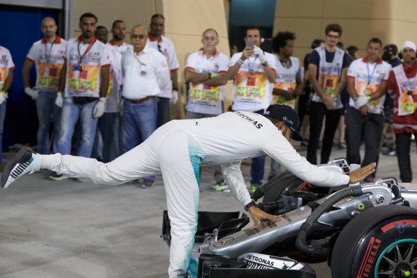 Bahrain International Circuit, Sakhir, Bahrain. Saturday 2 April 2016. Lewis Hamilton, Mercedes AMG, celebrates pole in Parc Ferme. World Copyright: Steve Etherington/LAT Photographic ref: Digital Image SNE25292