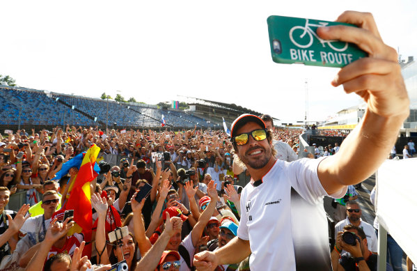 Hungaroring, Budapest, Hungary. Thursday 21 July 2016. Fernando Alonso, McLaren takes a selfie with the fans. World Copyright: Steven Tee/LAT Photographic ref: Digital Image _H7I0170