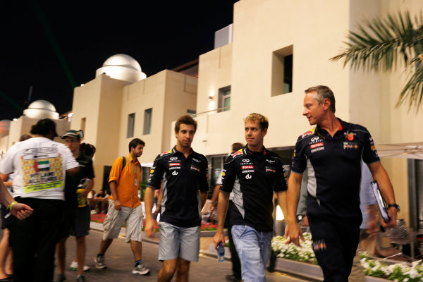 Yas Marina Circuit, Abu Dhabi, United Arab Emirates. Friday 1st November 2013. Sebastian Vettel, Red Bull Racing leaves the paddock wth Jonathan Wheatley, Team Manager, Red Bull Racing and Antonio Felix da Costa, Red Bull Racing. World Copyright: Charles Coates/LAT Photographic. ref: Digital Image _N7T0626