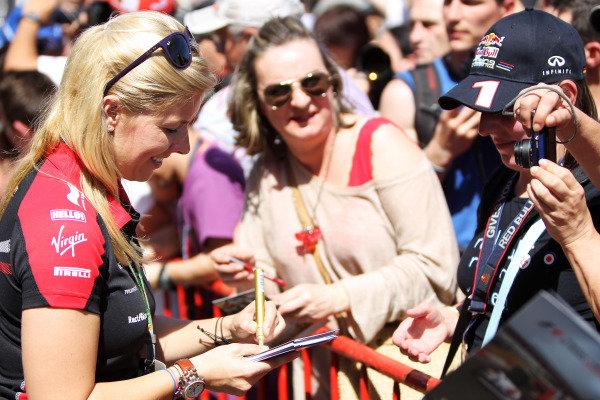 Circuit de Catalunya, Barcelona, Spain 10th May 2012 Maria de Villota, Marussia MR01 Cosworth signs autographs for fans. World Copyright:Glenn Dunbar/LAT Photographic ref: Digital Image CG8C0430
