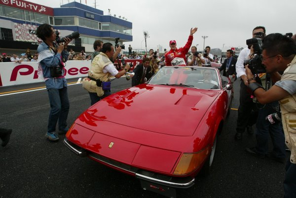 Michael Schumacher (GER) Ferrari takes to the drivers' parade in a Ferrari Daytona Spider