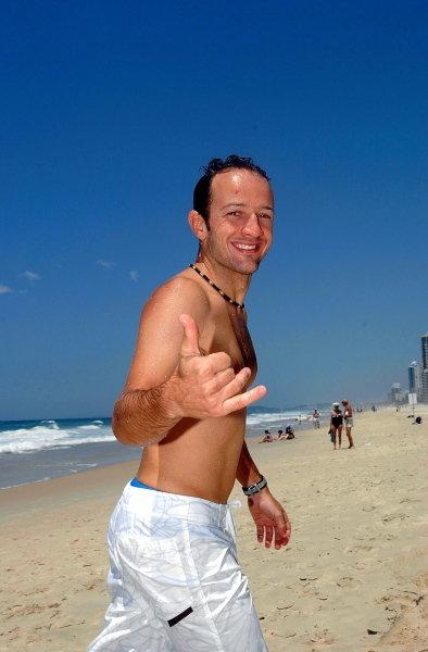 Cristiano da Matta (BRA) relaxes on the beach.CART Fedex Series Race Preparations, Rd17, Honda Indy 300, Surfers Paradise, Australia, 23 October 2002.DIGITAL IMAGE