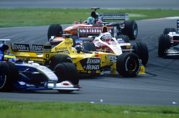 Sepang, Kuala Lumpur, Malaysia. 15-17 October 1999. Damon Hill (Jordan 199 Mugen Honda) spins out after contact from Giancarlo Fisichella at the start of the race. Alex Zanardi (Williams FW21 Supertec) tries to avoid the Jordan. Action. Ref: 99MAL02. World Copyright - LAT Photographic