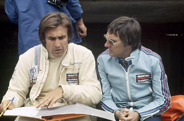 1975 Belgian Grand Prix.Zolder, Belgium. 25 May 1975.Bernie Ecclestone (right) with Carlos Reutemann, Brabham BT44B-Ford, 3rd position, portrait.World Copyright: LAT PhotographicRef: 35mm transparency 75BEL