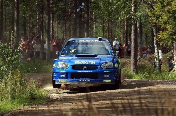 Tommi Makinen (FIN) jumps his Subaru Impreza WRC 2003 on stage 12.FIA World Rally Championship, Rd9, Neste Rally Finland, Jyvaskyla, Finland. Day 2, 9 August 2003.DIGITAL IMAGE