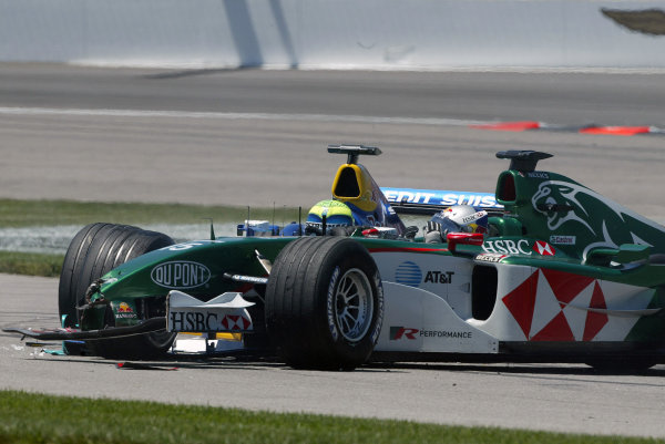 2004 United States Grand Prix - Sunday Race,2004 United States Grand PrixIndianapolis, USA. 20th June 2004 Christian Klien, Jaguar R5 gestures to Felipe Massa, Sauber Petronas C23 as they both sit in their cars after their first corner crash.World Copyright: Steve Etherington/LAT Photographic ref: Digital Image Only