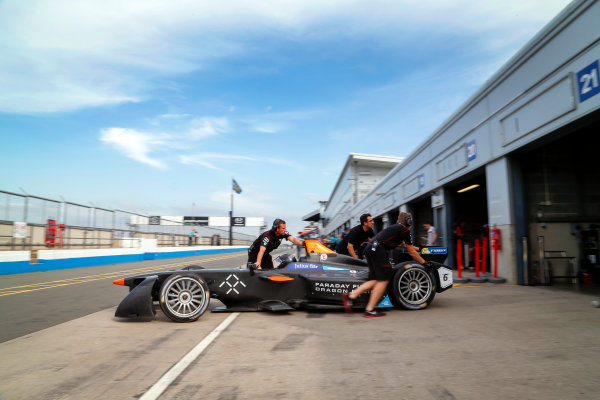 FIA Formula E Season 3 Testing - Day Two. Donington Park Racecourse, Derby, United Kingdom. The Spark-Penske of Loic Duval, Faraday Future Dragon Racing, is pushed back into the garage in the pit lane. Wednesday 24 August 2016. Photo: Adam Warner / LAT / FE. ref: Digital Image _14P2873