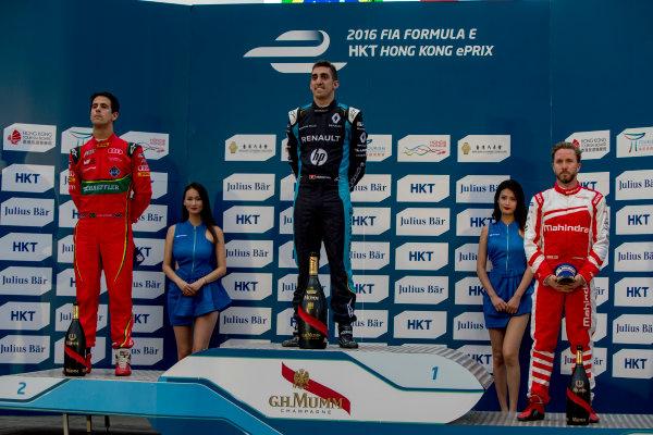 2016/2017 FIA Formula E Championship. Hong Kong ePrix, Hong Kong, China. Sunday 9 October 2016. Lucas Di Grassi (BRA), ABT Schaeffler Audi Sport, Spark-Abt Sportsline, ABT Schaeffler FE02, Sebastien Buemi (SUI), Renault e.Dams, Spark-Renault, Renault Z.E 16 and Nick Heidfeld (GER), Mahindra Racing, Spark-Mahindra, Mahindra M3ELECTRO on the podium. Photo: Zak Mauger/LAT/Formula E ref: Digital Image _X0W2885