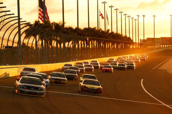 14-16 November, 2014, Homestead, Florida USA Denny Hamlin leads a restart  ©2014, Michael L. Levitt LAT Photo USA