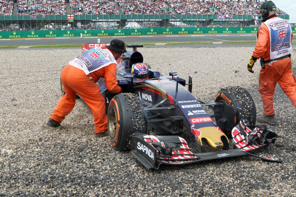 Marshals attend to Max Verstappen (NED) Scuderia Toro Rosso STR10 after crashing into the gravel at Formula One World Championship, Rd9, British Grand Prix, Race, Silverstone, England, Sunday 5 July 2015.