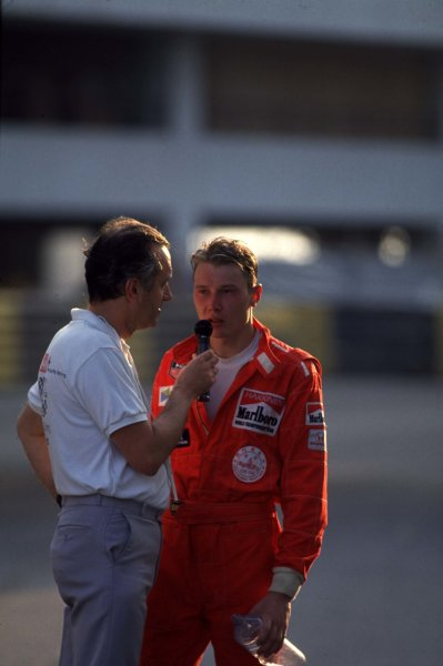 1990 Macau Formula 3 Grand Prix.  Macau, China. 25th November 1990. Mika Hakkinen explains the collision with Michael Schumacher which lost him the race portrait.  World Copyright: LAT Photographic. Ref: 90F3MAC03.