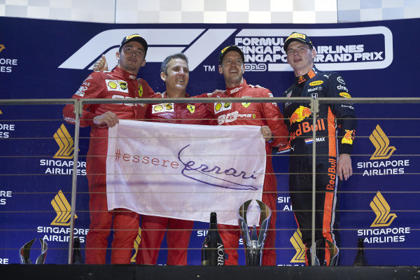 Charles Leclerc, Ferrari, 2nd position, Iñaki Rueda, Head of Strategy, Ferrari, Sebastian Vettel, Ferrari, 1st position, and Max Verstappen, Red Bull Racing, 3rd position, on the podium