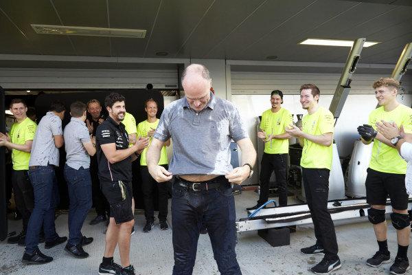 The Mercedes team celebrate victory
