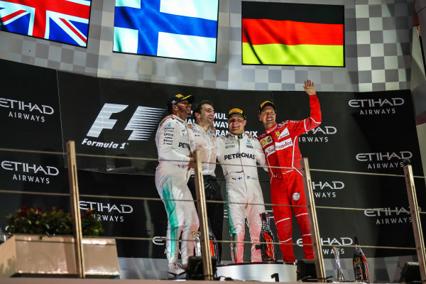 Lewis Hamilton (GBR) Mercedes AMG F1, Valtteri Bottas (FIN) Mercedes AMG F1 and Sebastian Vettel (GER) Ferrari celebrate on the podium at Formula One World Championship, Rd20, Abu Dhabi Grand Prix, Race, Yas Marina Circuit, Abu Dhabi, UAE, Sunday 26 November 2017.
