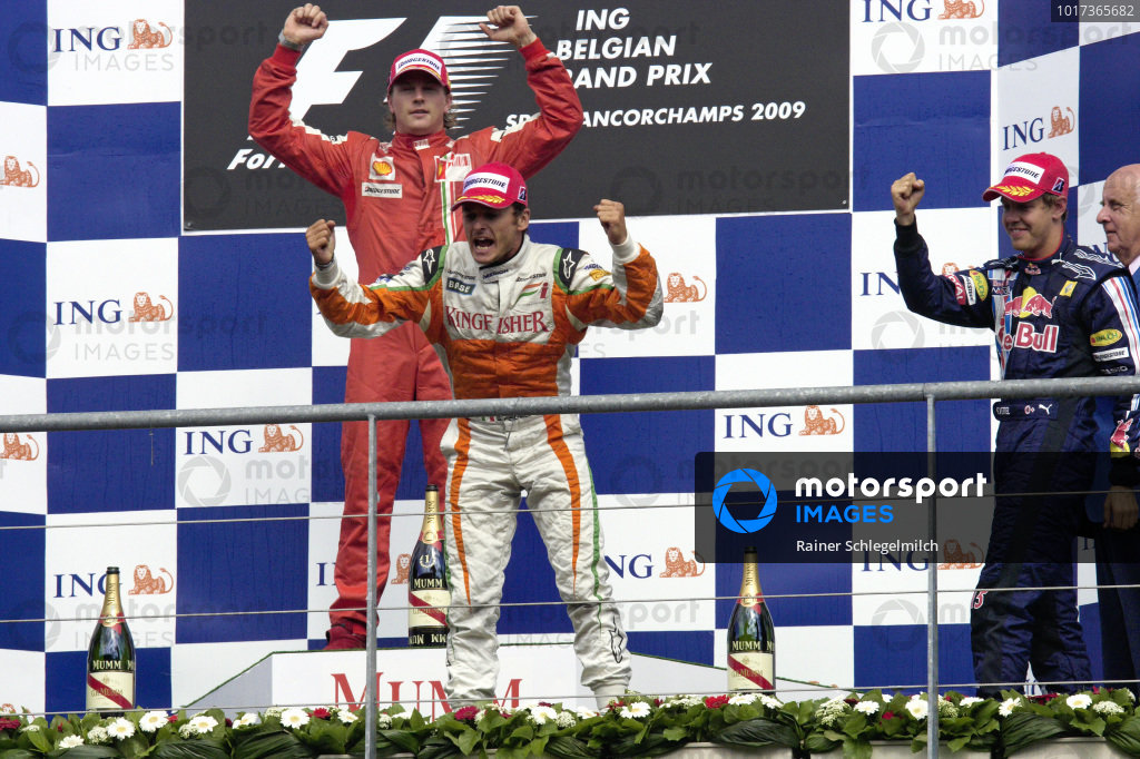 Second placed Giancarlo Fisichella cheers loudly from podium with winner Kimi Räikkönen and Sebastian Vettel, 3rd position.