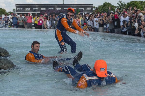 Scott Dixon, Chip Ganassi Racing Honda, with crew in Scott Fountain after race win.