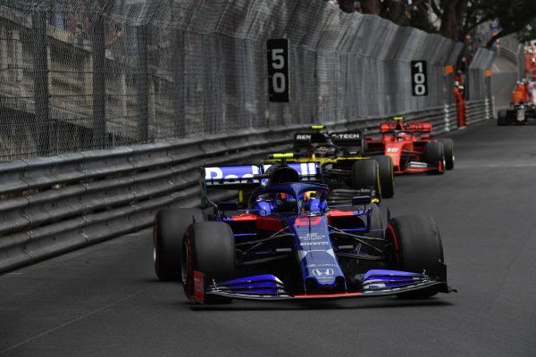 Alexander Albon, Toro Rosso STR14, leads Nico Hulkenberg, Renault R.S. 19, and Charles Leclerc, Ferrari SF90