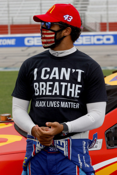 """Bubba Wallace, Richard Petty Motorsports Chevrolet McDonald's,  wears  a """"I Can't Breath - Black Lives Matter"""" T-shirt under his fire suit in solidarity with protesters around the world taking to the streets after the death of George Floyd on May 25 while in the custody of Minneapolis, Minnesota police, Copyright: Chris Graythen/Getty Images."""