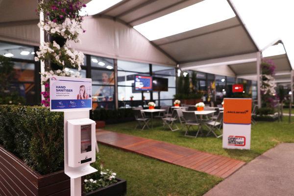 Hand Sanitiser dispenser outside the empty McLaren hospitality area in the paddock