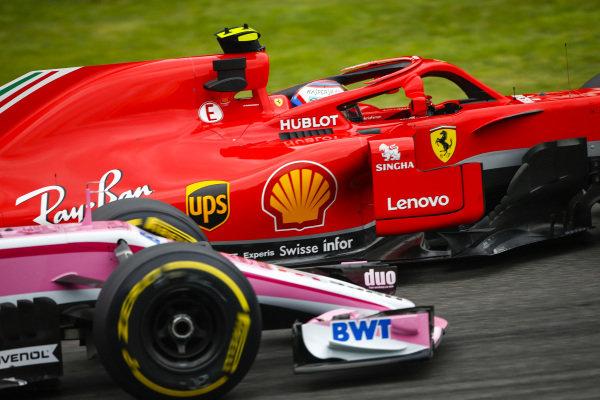 Kimi Raikkonen, Ferrari SF71H, leads Sergio Perez, Racing Point Force India VJM11 Mercedes.