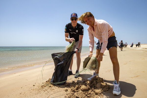 Johan Kristoffersson (SWE), Rosberg X Racing, and Nico Rosberg, founder and CEO, Rosberg X Racing, collect litter on the beach