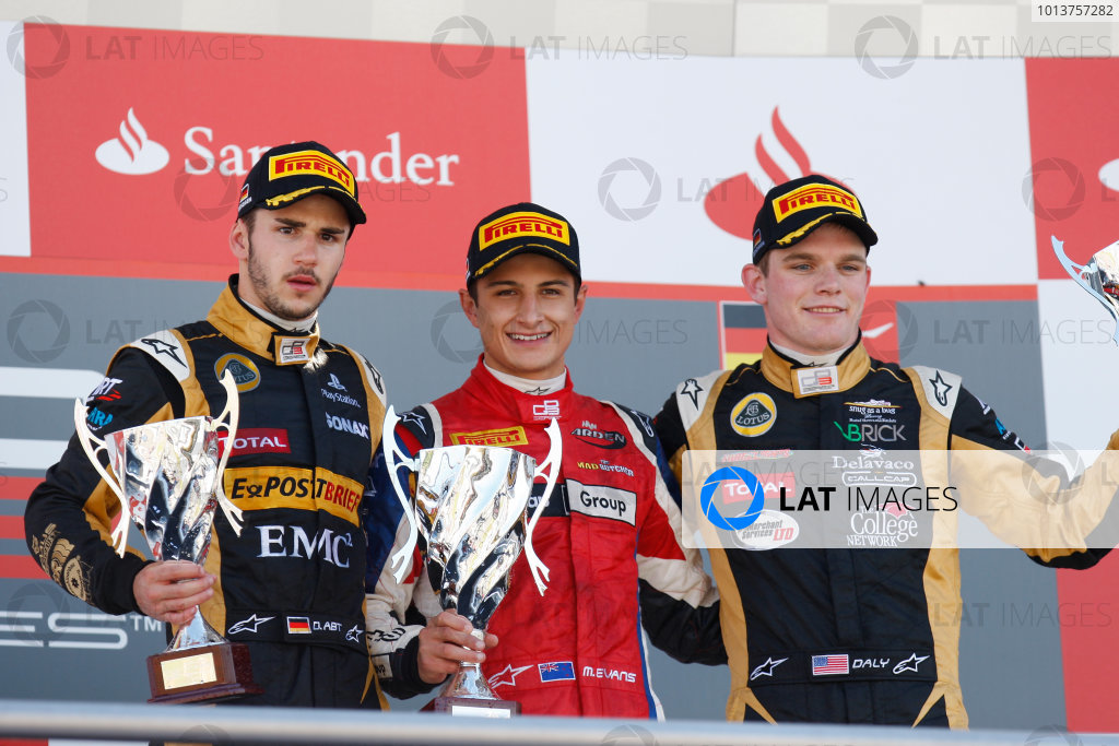Hockenheim, Germany. 22nd July 2012. Sunday Race 2.(LtoR) 2nd place Daniel Abt (GER, Lotus GP) 1st place Mitch Evans (NZL, MW Arden) 3rd place Conor Daly (USA, Lotus GP) on the podium. Portrait. World Copyright:  Alastair Staley/LAT Photographic Ref: Digital Image _O9T2144.JPG