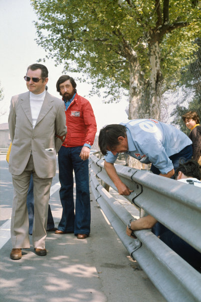 Montjuich Park, Barcelona, Spain. 25-27 April 1975. Ken Tyrrell examines the armco barriers, which were the subject of concern causing a driver protest. Ref: 75ESP03. World Copyright - LAT Photographic