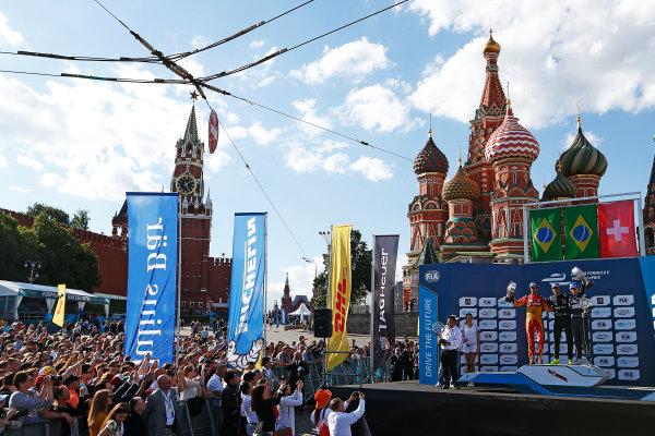 2014/2015 FIA Formula E Championship.  Moscow e-Prix, Moscow, Russia. Saturday 6 June 2015. Nelson Piquet Jr (BRA)/China Racing - Spark-Renault SRT_01E, Lucas di Grassi (BRA)/Audi Abt Sport - Spark-Renault SRT_01E & Sebastien Buemi (SWI)/E.dams Renault - Spark-Renault SRT_01E on the podium Photo: Sam Bloxham/LAT/Formula E ref: Digital Image _SBL5944
