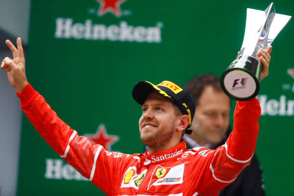 Shanghai International Circuit, Shanghai, China.  Sunday 09 April 2017.  Sebastian Vettel, Ferrari, 2nd Position, celebrates with his trophy on the podium. World Copyright: Steven Tee/LAT Images  ref: Digital Image _O3I5496