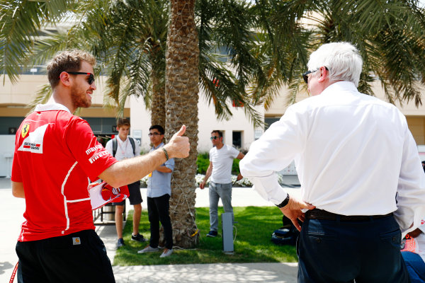 Bahrain International Circuit, Sakhir, Bahrain.  Thursday 13 April 2017. Sebastian Vettel, Ferrari, talks with Charlie Whiting, Race Director, FIA, in the paddock. World Copyright: Sam Bloxham/LAT Images ref: Digital Image _J6I8357