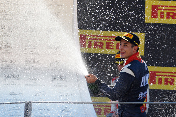 2015 GP2 Series Round 8. Autodromo Nazionale di Monza, Monza, Italy. Sunday 6 September 2015. Mitch Evans (NZL, RUSSIAN TIME) celebrates on the podium. World Copyright: Sam Bloxham/LAT Photographic. ref: Digital Image _G7C2255