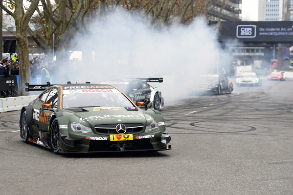 Pascal Wehrlein (GER) DTM Mercedes AMG C-Coupe performs a burn out. Mercedes-Benz Stars and Cars, Mercedes-Benz Museum, Stuttgart, Germany, 29 November 2014.