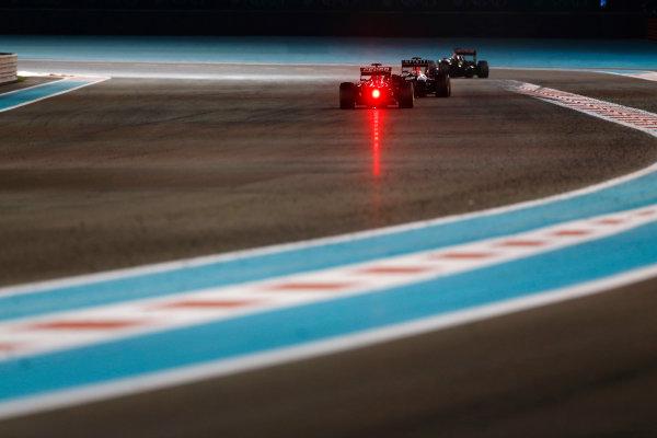 Yas Marina Circuit, Abu Dhabi, United Arab Emirates. Sunday 29 November 2015. Daniil Kvyat, Red Bull Racing RB11 Renault, leads Carlos Sainz Jr, Toro Rosso STR10 Renault. World Copyright: Sam Bloxham/LAT Photographic ref: Digital Image _SBL9425