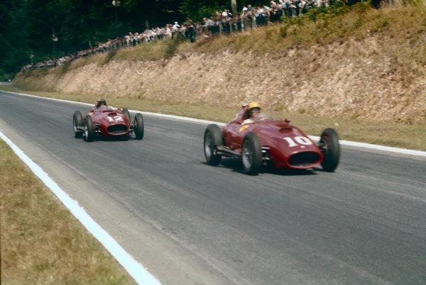 Rouen-Les-Essarts, France. 5-7 July 1957. Luigi Musso (Lancia Ferrari 801) 2nd position, leads Peter Collins (Lancia Ferrari 801) 3rd position. Ref-57 FRA 21. World Copyright - LAT Photographic