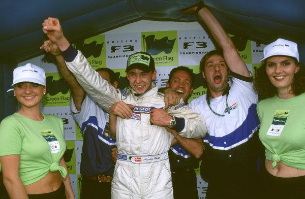 2000 British Formula Three Donington, England. 1st - 2nd July 2000. Rd 7&8. Nicolas Kiesa and team celebrate Race 2 victory. World - Peter Spinney/ LAT Photographic