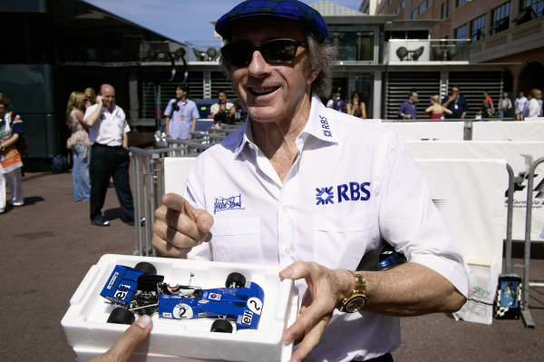 Sir Jackie Stewart with a model of his 1971 Tyrrell 003.