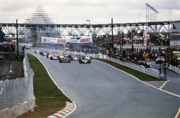 Pole sitter Jean-Pierre Jarier, Lotus 79 Ford leads the field at the start with Jody Scheckter, Wolf WR5 Ford alongside.