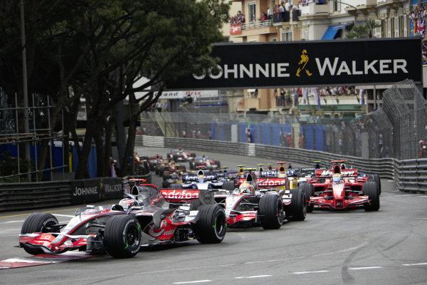 Fernando Alonso, McLaren MP4-22 Mercedes leadsLewis Hamilton, McLaren MP4-22 Mercedes and Felipe Massa, Ferrari F2007 at the start.