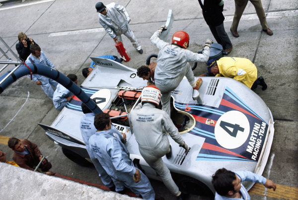 Helmut Marko takes over driving duties from Gijs van Lennep during a pitstop for the International Martini Racing Team, Porsche 908/03.