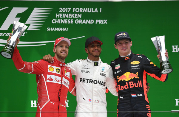 (L to R): Sebastian Vettel (GER) Ferrari, Lewis Hamilton (GBR) Mercedes AMG F1 and Max Verstappen (NED) Red Bull Racing celebrate on the podium with the trophies at Formula One World Championship, Rd2, Chinese Grand Prix, Race, Shanghai, China, Sunday 9 April 2017.