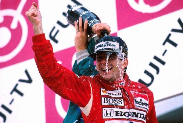 Winner Ayrton Senna (BRA) celebrates his win and world championship on the podium Japanese GP, Suzuka, 30th October 1988.