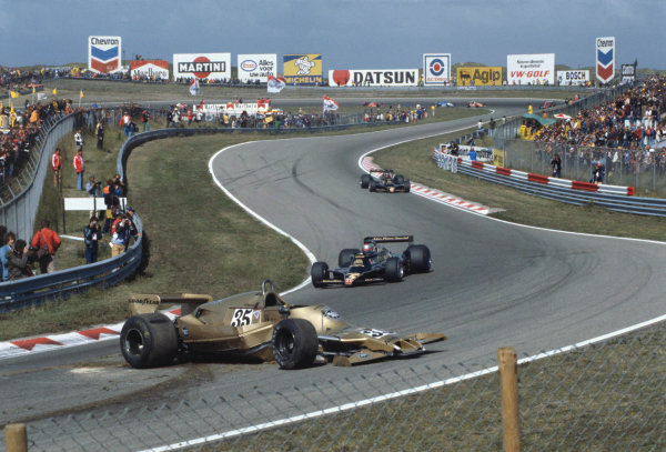 1978 Dutch Grand Prix.Zandvoort, Holland. 25-27 August 1978.Mario Andretti and Ronnie Peterson (both Lotus 78 Ford's) pass the crashed car of Riccardo Patrese (Arrows A1-Ford Cosworth). They finished in 1st and 2nd positions respectively.A Race Through Time exhibition number 75.World Copyright - Dunbar/LAT Photographic