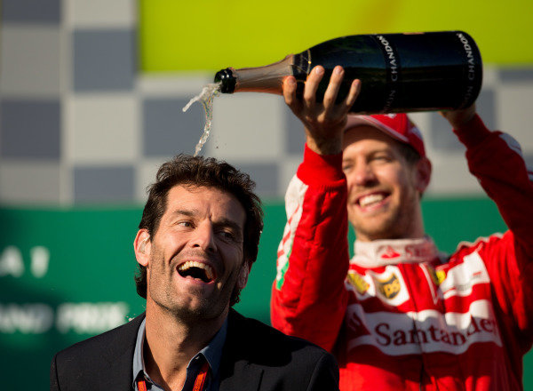 Sebastian Vettel (GER) Ferrari and Mark Webber (AUS) celebrate with champagne on the podium at Formula One World Championship, Rd1, Australian Grand Prix, Race, Albert Park, Melbourne, Australia, Sunday 20 March 2016.
