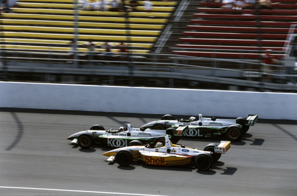 Dario Franchitti, Team Green, Reynard 01i Honda, leads Paul Tracy, Team Green, Reynard 01i Honda, and Kenny Bräck, Team Rahal, Lola B1/00 Ford.