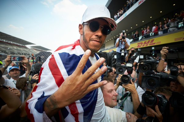 Autodromo Hermanos Rodriguez, Mexico City, Mexico. Sunday 29 October 2017. Lewis Hamilton, Mercedes AMG, holds up four fingers to the camera in recognition of securing his 4th world drivers championship title. World Copyright: Steve Etherington/LAT Images  ref: Digital Image SNE14498