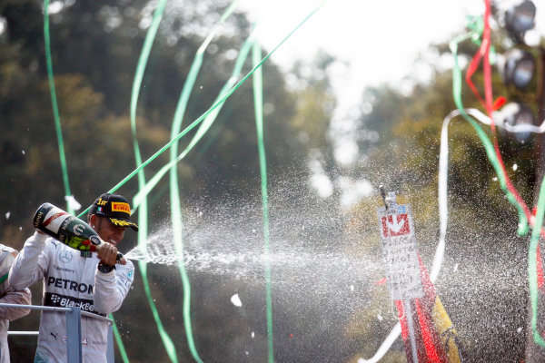 Autodromo Nazionale di Monza, Monza, Italy. Sunday 7 September 2014. Lewis Hamilton, Mercedes AMG, 1st Position, sprays Champagne from the podium. World Copyright: Steven Tee/LAT Photographic. ref: Digital Image _X0W4604