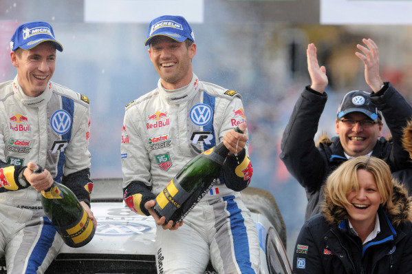 Rally winners Sebastien Ogier (FRA) and Julien Ingrassia (FRA), VW Polo R WRC, spray champagne on the podium. FIA World Rally Championship, Rd13, Wales Rally GB, Deeside, Wales, Day Three, Sunday 17 November 2013.