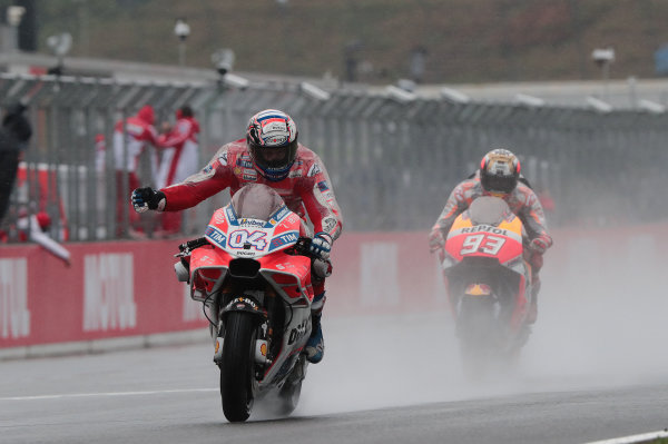2017 MotoGP Championship - Round 15 Motegi, Japan. Sunday 15 October 2017 Race winner Andrea Dovizioso, Ducati Team, second place Marc Marquez, Repsol Honda Team World Copyright: Gold and Goose / LAT Images ref: Digital Image 697551